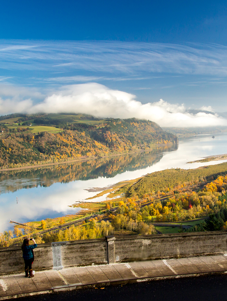 A woman looking over the Columbia River Gorge